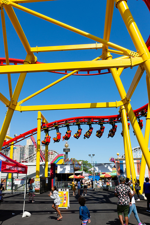 The Phoenix roller coaster at Deno's Wonder Wheel amusement park in Coney Island, a steel-framed roller coaster in which riders sit in chairs suspended from an overhead track.