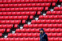 Bristol Rovers manager Ben Garner stands in front of a empty stand during his team's fixture with Sunderland played behind closed doors due to Covid-19 protocols - Mandatory by-line: Robbie Stephenson/JMP - 12/09/2020 - FOOTBALL - Stadium of Light - Sunderland, England - Sunderland v Bristol Rovers - Sky Bet League One