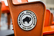 SHOT 10/23/17 1:56:38 PM - Orange seats from the Buffalo Memorial Auditorium on display at Canalside in Buffalo, N.Y. Buffalo Memorial Auditorium was an indoor arena in downtown Buffalo, New York. Opened on October 14, 1940, it hosted the AHL's Buffalo Bisons, the NHL's Buffalo Sabres, the NBA's Buffalo Braves, the MSL's Buffalo Stallions, the MILL's Buffalo Bandits, the second NPSL's Buffalo Blizzard and the RHI's Buffalo Stampede. It also hosted a number an NCAA basketball games, as well as entertainment events such as concerts, the Ringling Brothers circus and Disney on Ice. The Aud was renovated in 1970 and 1990, and it closed in 1996 after the Sabres', Bandits', and Blizzard's seasons ended. It remained vacant until the city demolished it in 2009. Buffalo, N.Y. is the second most populous city in the state of New York and is located in Western New York on the eastern shores of Lake Erie and at the head of the Niagara River. By 1900, Buffalo was the 8th largest city in the country, and went on to become a major railroad hub, the largest grain-milling center in the country and the home of the largest steel-making operation in the world. The latter part of the 20th Century saw a reversal of fortunes: by the year 1990 the city had fallen back below its 1900 population levels. (Photo by Marc Piscotty / © 2017)