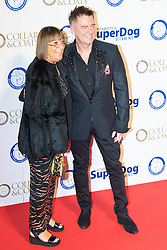 """Battersea, London, November 3rd 2016.  Celebrities and their dogs attend The Evolution at Battersea Park to attend The Battersea Dogs and Cats Home """"Collars and Coats Ball"""". PICTURED: Hilary Alexander and Charles Worthington"""