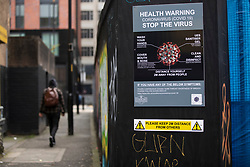 © Licensed to London News Pictures. 16/10/2020. Manchester, UK. A sign warns passers by in Manchester of the health risks of Coronavirus and advises them to take precautions. Manchester is on the verge of a Tier 3 lockdown. Photo credit: Kerry Elsworth/LNP