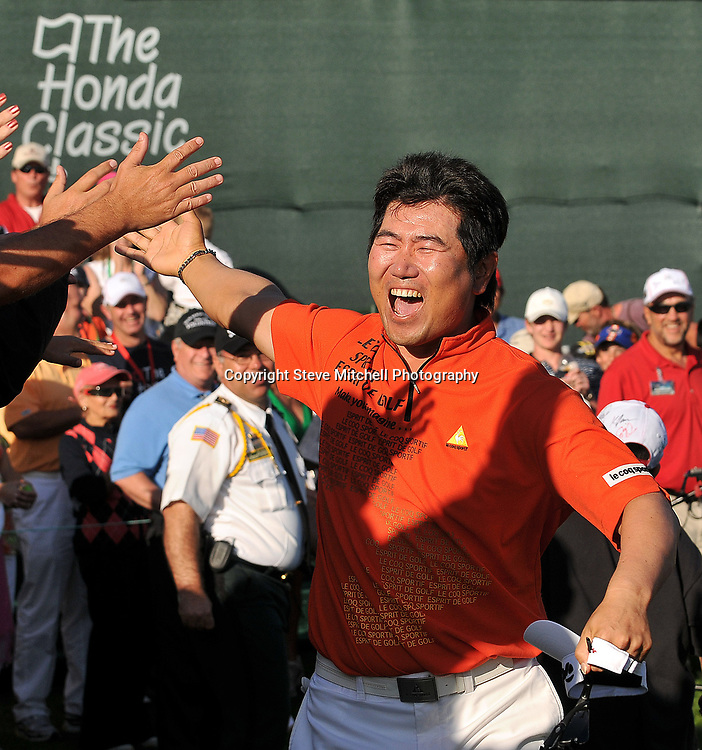 Mar 8, 2009; Palm Beach Gardens, FL, USA;Y.E. Yang (KOR) celebrates with the fans after winning the Honda Classic at the PGA National Resort & Spa. Mandatory Credit: Photo by Steve Mitchell