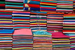 Stacks of cloth and textiles, Fes al Bali medina, Fes, Morocco