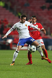 December 5, 2017 - Lisbon, Portugal - Basel's midfielder Taulant Xhaka from Albania (L) fights for the ball with Benfica's Portuguese midfielder Joao Carvalho during the UEFA Champions League Group A football match between SL Benfica and FC Basel at the Luz stadium in Lisbon, Portugal on December 5, 2017. Photo: Pedro Fiuza (Credit Image: © Pedro Fiuza via ZUMA Wire)