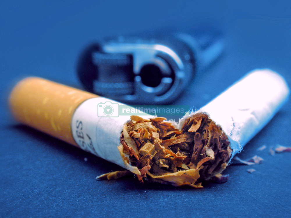 Undated file photo of a cigarette and a lighter. A French study found that only 4.4% of 350 coronavirus patients hospitalized were regular smokers and 5.3% of 130 homebound patients smoked. This pales in comparison with at least 25% of the French population that smokes. Researchers theorized nicotine could prevent the virus from infecting cells or that nicotine was preventing the immune system from overreacting to the virus. To test this theory, hospitalized coronavirus patients, intensive care patients and frontline workers nicotine patches. Photo by Artpartner/ANDBZ/ABACAPRESS.COM