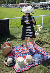 © Licensed to London News Pictures. 10/05/2017. Windsor, UK. A visitor to the Royal Windsor Horse Show stands on a Union flag decorated picnic blanket. The five day equestrian event takes place in the grounds of Windsor Castle. Photo credit: Peter Macdiarmid/LNP