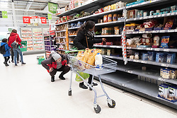 © Licensed to London News Pictures. 03/03/2020. London, UK. Shoppers buying items in a Asda supermarket in Wembley as more Coronavirus disease cases are reported in the the UK. Photo credit: London News Pictures