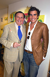 Left to right, BARRY HUMPHRIES and OSCAR HUMPHRIES  at an exhibition of art by Oscar Humphries entitles 'Post-Nuclear Family' held at Nutters, Lower Ground, 12 Savile Row, London on 8th June 2006.<br /><br />NON EXCLUSIVE - WORLD RIGHTS