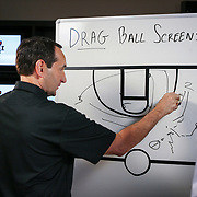 Duke head basketball coach Mike Krzyzewski draws out a play during a live broadcast at ESPN's studio in Charlotte, N.C. ©Travis Bell Photography