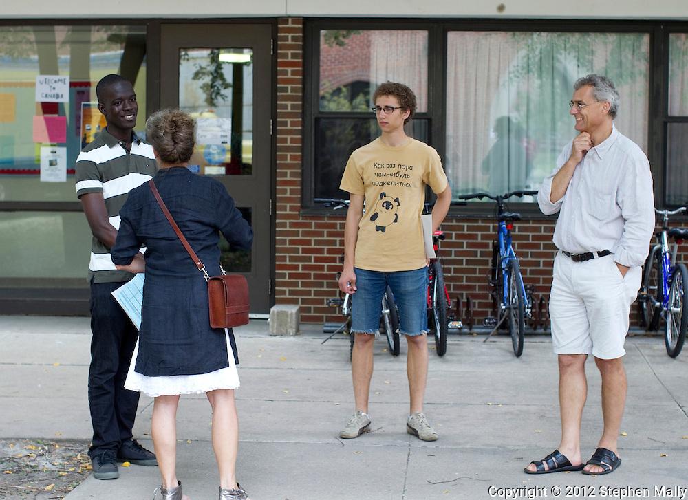 Reggie Sackey-Addo (from left), 17, of Accra, Ghana talks with Alicja Boruta-Sadkowski of Cedar Falls, Iowa as Karl Sadkowski, 18, and Konrad Sadkowski both of Cedar Falls, Iowa look on at Grinnell College in Grinnell, Iowa on Saturday, August 25, 2012. Konrad Sadkowski and Alicja Boruta-Sadkowski are Karl Sadowski's parents.