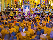 02 APRIL 2015 - CHIANG MAI, CHIANG MAI, THAILAND: Buddhist monks and novices pray in Wat Chedi Luang in Chiang Mai during a prayer service to mark the 60th Birthday celebrations for HRH Princess Maha Chakri Sirindhorn (in the portrait in the center of photo), daughter of Bhumibol Adulyadej, the King of Thailand, and his wife, Queen Sirikit. The Princess is revered by most Thais and her birthday is celebrated throughout Thailand.    PHOTO BY JACK KURTZ