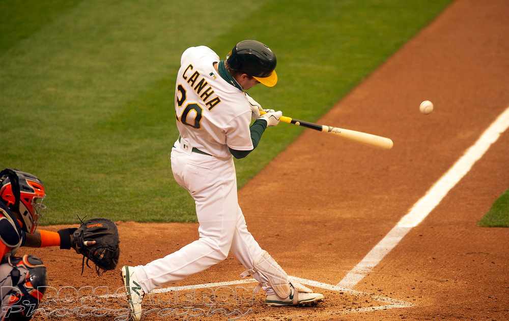 Sep 10, 2020; Oakland, California, USA; Oakland Athletics Mark Canha (20) connects for a single against the Houston Astros during the fifth inning of a baseball game at Oakland Coliseum. Mandatory Credit: D. Ross Cameron-USA TODAY Sports