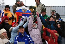 Russian fans get flowers from the winner at Men 20 km Individual at E.ON Ruhrgas IBU World Cup Biathlon in Hochfilzen (replacement Pokljuka), on December 18, 2008, in Hochfilzen, Austria. (Photo by Vid Ponikvar / Sportida)