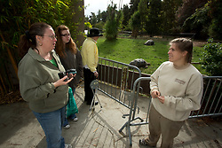 Chelsea Williams, right, a zookeeper at the Oakland Zoo, chats with zoo visitors Peggy Read of Los Banos, Calif., left, and Read's 13-year-old daughter Rachel, Tuesday, Oct. 23, 2012 in Oakland, Calif. Rachel wanted to know how she could become a zookeeper, and if there were any programs offered by the zoo to that end. (D. Ross Cameron/Staff)