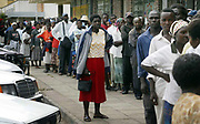 A queue for meali meal in Mutare, Zimbabwe. The poor and impoverished citizens wait patiently for their free food.