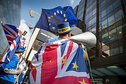 © Licensed to London News Pictures. 30/04/2019. London, UK. Anti-Brexit campaigner Steve Bray stands outside Labour Party headquarters with a giant megaphone. A National Executive Meeting is in progress at which Labour's position on a second EU vote will be decided. Photo credit: Peter Macdiarmid/LNP