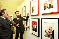 """14 FEB 2005, BERLIN/GERMANY:<br /> Gerhard Schroeder, SPD, Bundeskanzler, Stefan Aust, Chefredaktuer Der Spiegel, Gabor Steingart, Leiter Hauptstadtbuero Der Spiegel, (v.L.n.R.), betrachen Bilder, die Schroeder sowie Schroeder und Lafontaine, in der  Ausstellung """"Die Kunst des Spiegel"""", C/O Berlin, The Cultural Forum for Photography<br /> IMAGE:20050214-02-027<br /> KEYWORDS: Titelbilder, Gerhard Schröder"""