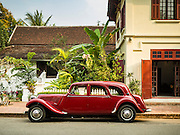 "12 MARCH 2016 - LUANG PRABANG, LAOS:  A1952 Citroen Model 11, one of only two of that model in Laos, at 3 Nagas, one of the most upscale hotels in Luang Prabang. Luang Prabang was named a UNESCO World Heritage Site in 1995. The move saved the city's colonial architecture but the explosion of mass tourism has taken a toll on the city's soul. According to one recent study, a small plot of land that sold for $8,000 three years ago now goes for $120,000. Many longtime residents are selling their homes and moving to small developments around the city. The old homes are then converted to guesthouses, restaurants and spas. The city is famous for the morning ""tak bat,"" or monks' morning alms rounds. Every morning hundreds of Buddhist monks come out before dawn and walk in a silent procession through the city accepting alms from residents. Now, most of the people presenting alms to the monks are tourists, since so many Lao people have moved outside of the city center. About 50,000 people are thought to live in the Luang Prabang area, the city received more than 530,000 tourists in 2014.      PHOTO BY JACK KURTZ"