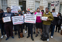 London, UK. 23rd June, 2021. Campaigners against LGBT+ conversion therapy, including Jayne Ozanne of the Ban Conversion Therapy Coalition and veteran LGBT+ and human rights activist Peter Tatchell, attend a picket outside the Cabinet Office and Government Equalities Office. They also handed in a petition signed by 7,500 people calling on the government to fulfil its 2018 promise to ban LGBT+ conversion therapy.