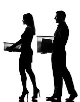 one caucasian couple man and woman walking carrying boxes happy full length in studio silhouette isolated on white background