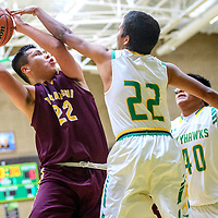 Tohatchi Cougar Elijah Tsosie (22), left, is pressured by Newcomb Skyhawk Deondre Begay (22) in the boys District 1-3A championship at Newcomb High School Friday.
