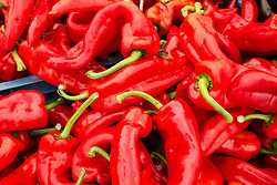 Detail of red peppers on market stall