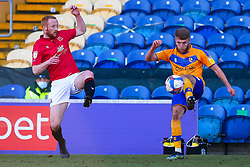 Jason Law of Mansfield Town hoofs the ball away from Liam Gibson of Morecambe - Mandatory by-line: Ryan Crockett/JMP - 27/02/2021 - FOOTBALL - One Call Stadium - Mansfield, England - Mansfield Town v Morecambe - Sky Bet League Two
