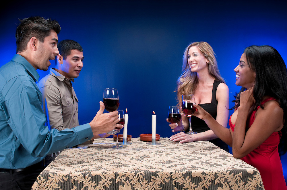 Group of friends drinking wine and celebrating.