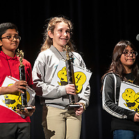The top three winners at the Gallup-McKinley County Schools annual spelling bee at Gallup High School, Wednesday, Jan. 16. Left to right, Srikar Venigalla, 10, from Red Rock Elementary comes in second place, Amalia Wagner, 12, from Gallup Middle School wins first place and Hailey Martinez, 11, from Roosevelt Elementary places third. First and second place go to the state spelling bee at Sandia Prep in March.