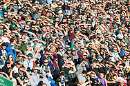 Fans shield their eyes as they look towards the low October sun during the EFL Sky Bet League 1 match between Plymouth Argyle and Burton Albion at Home Park, Plymouth, England on 20 October 2018.