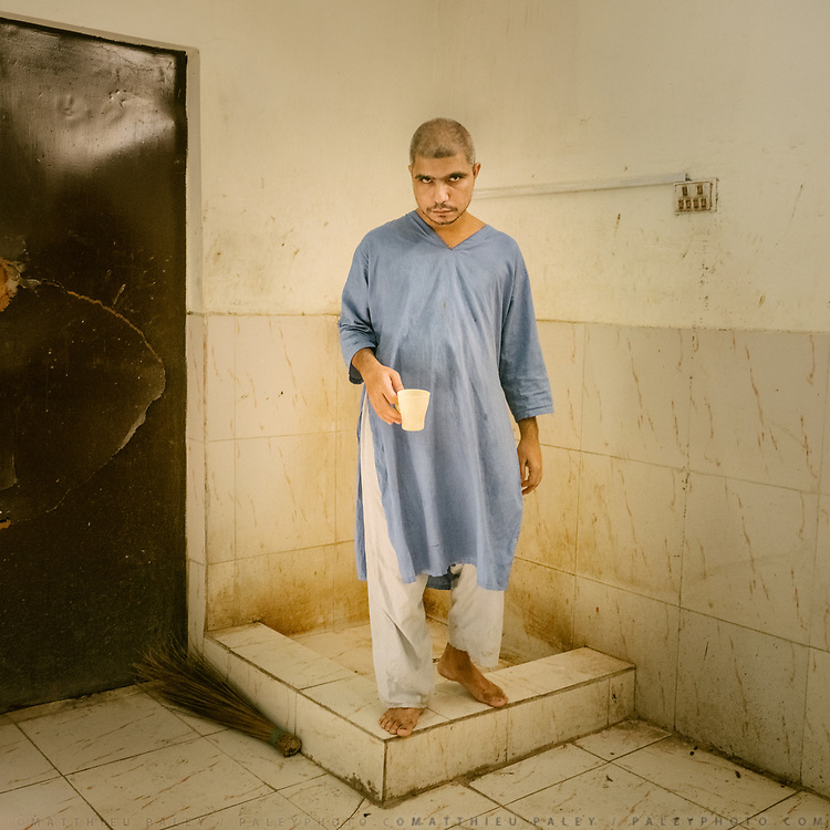A patient gets water at a mental asylum in Hyderabad city.