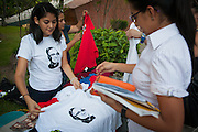 """Romero, Martyr of Love"" tshirt sales are brisk at the University of San Savvador as El Salvador prepares for the beatification ceremony and mass announcing the beatification of Archbishop Oscar Romero. The Archbishop was slain at the alter of his Church of the Divine Providence by a right wing gunman in 1980. Oscar Arnulfo Romero y Galdamez became the fourth Archbishop of San Salvador, succeeding Luis Chavez, and spoke out against poverty, social injustice, assassinations and torture. Romero was assassinated while offering Mass on March 24, 1980."