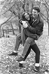 Woman carrying a man in Central Park, NY