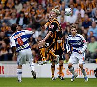 Fotball<br /> Foto: SBI/Digitalsport<br /> NORWAY ONLY<br /> <br /> Hull City v Queens Park Rangers<br /> Coca Cola Championship.<br /> 06/08/2005.<br /> <br /> Hull's Steve McPhee (C) rises to head goalwards.