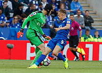 Football - 2016/2017 Premier League - Leicester Ciity V Arsenal. <br /> <br /> Petr Cech of Arsenal lives dangerously as he takes the ball past an on rushing Jamie Vardy of Leicester City at The King Power Stadium.<br /> <br /> COLORSPORT/DANIEL BEARHAM