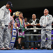 """Orlando Cruz (green trunks) , ranked as the #4 Lightweight by the WBO, is introduced prior to his fight against Jorge Pazos at the Kissimmee Civic Center in Kissimmee, Florida, on Friday, October 19, 2012. The Puerto Rican Cruz recently described himself as """"a proud gay man"""" and the first active boxer having pronounced so, in boxing history. Cruz won the fight in a 12-round decision. (AP Photo/Alex Menendez)"""