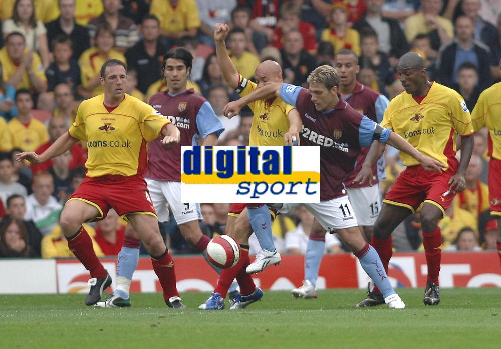 Photo: Richard Lane.<br />Watford v Aston Villa. The Barclays Premiership. 16/09/2006. <br />Villa's Stilian Petrov is challenged by Watford's Gavin Mohon.