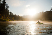 Morning kayaking on the river in Jackson, with sun and mist