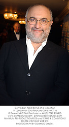 Comedian ALEXI SAYLE at a reception in London on 23rd February 2003.PHK 136