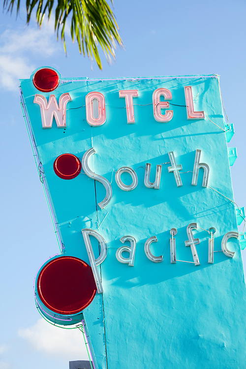 """The South Pacific Motel, designed by Charles Giller in 1953, features a dramatic, Miami Modern pylon. In the 2010s, new owner Avra Jain reimagined the motel rooms as """"Work/Office Suites,"""" and officially transformed the motel into a """"Wotel"""" by inverting the letter """"M"""" in the sign."""