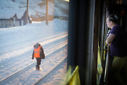 Passenger looking outside from a cabin on the BAM (Baikal-Amur Mainline), Siberia. Russia