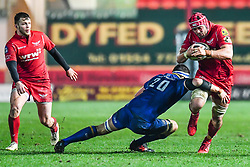 Scarlets' Josh Macleod is tackled by Leinster's Max Deegan<br /> <br /> Photographer Craig Thomas/Replay Images<br /> <br /> Guinness PRO14 Round 17 - Scarlets v Leinster - Friday 9th March 2018 - Parc Y Scarlets - Llanelli<br /> <br /> World Copyright © Replay Images . All rights reserved. info@replayimages.co.uk - http://replayimages.co.uk