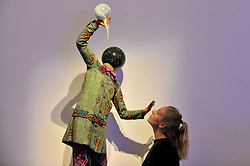 "© Licensed to London News Pictures. 12/10/2017. London, UK.  A staff member view ""Bad School Boy"", 2014, by Yinka Shonibare (Est. GBP70-90k) at a preview of artworks for the ""Art for Grenfell"" auction taking place at Sotheby's, New Bond Street, on 16 October.  Leading contemporary artists have agreed to donate works to the auction, the proceeds of which will be divided equally amongst the 158 surviving families of the Grenfell Tower fire by the Rugby Portobello Trust charity. Photo credit : Stephen Chung/LNP"