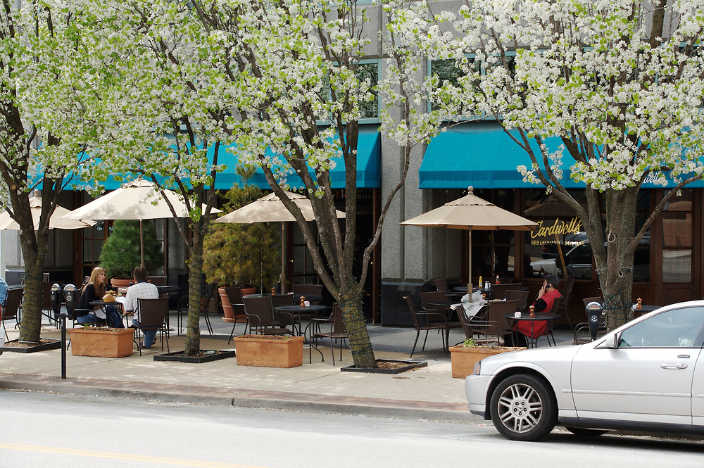 Outdoor dining with flowering trees at Cardwell's at the Plaza restaurant in Clayton, Missouri