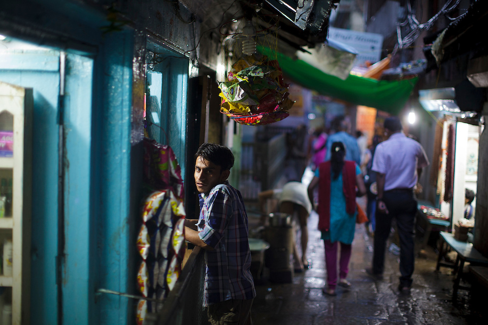 Young man in a shop in one alley at Varanasi in India.
