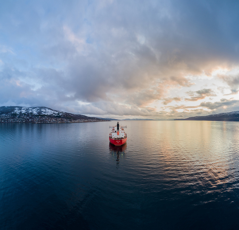 Aerial view of the bulk carrier 'Nordic Odin' anchored in the Ofot fjord in Narvik, Northern Norway.