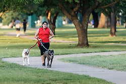 People walking dogs on the Trinity Trails near the Trinity River, Fort Worth, Texas, USA.