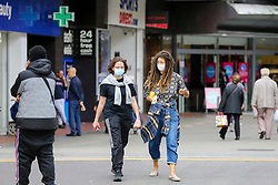 © Licensed to London News Pictures. 09/09/2020. London, UK. Women wearing face coverings on Wood Green High Road, in the London Borough of Haringey as the number of COVID19 cases increases. As at Sunday, September 6, the government reported a three-month high in coronavirus cases in England, with 2,988 lab-confirmed cases reported on that day, the highest number of new cases since May. According to the figures published by the COVID-19 Symptom Study app, Newham, has most active cases among London boroughs, with 97 per 100,000 people.<br /> The London Borough of Haringey has 75.7 cases per 100,000 people. Britain could be facing a nationwide curfew as part of the efforts to avoid a second wave. Photo credit: Dinendra Haria/LNP