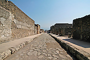 General view of Via di Mercurio with Vesuvius mountain in the background at the ruins at Pompeii, Campania, Italy under the Vesuvius volcano, July 2006