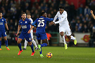 Leroy Fer of Swansea city is held back by Wilfred Ndidi of Leicester city.  Premier league match, Swansea city v Leicester City at the Liberty Stadium in Swansea, South Wales on Sunday 12th February 2017.<br /> pic by Andrew Orchard, Andrew Orchard sports photography.